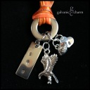 "EAGLE - Booster necklace with hand-stamped stainless steel tags, pewter eagle and football charms hung on a round washer. 18"" orange ribbon with stainless steel chain and clasp. $20 as shown."