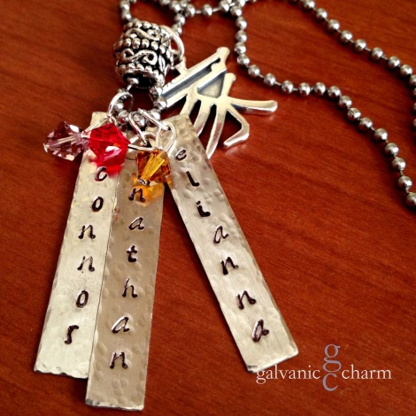 """FAMILY - Mother's necklace with 3 hand-stamped distressed stainless steel tags. Sterling silver Chinese """"family"""" character charm, moonstone, ruby and topaz Swarovski crystal birthstone drops, and intricate pewter bead. 20"""" stainless steel ball chain. $80 as shown."""