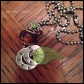 AIDAN - Mother's necklace with 2 hand-stamped washers in 1.5mm uppercase block font, sage green acrylic leaf, chestnut glass large hole bead, and pewter and light green rhinestone bead. Stainless steel ball chain. $35 as shown.