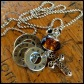 """AMBER - Grandma's necklace with 3 washers, each hand-stamped with sets of grandchildren's names. Stainless steel thick cross, amber-colored glass and black rhinestone beads. 24"""" stainless steel ball chain. $45 as shown."""
