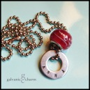 "ANNA - Child's necklace with single hand-stamped washer. Cherry-colored glass bead. 16"" stainless steel ball chain. $22 as shown."