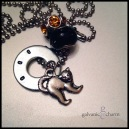 "BOO - 1 hand-stamped washer (boo) with pewter scary cat, textured black glass and amber rhinestone beads. 18"" stainless steel ball chain. $25 as shown."