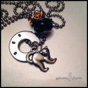 """BOO - 1 hand-stamped washer (boo) with pewter scary cat, textured black glass and amber rhinestone beads. 18"""" stainless steel ball chain. $25 as shown."""