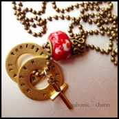 "BRASSY - Grandma's necklace with 2 brass washers, each hand-stamped with sets of grandchildren's names. Brass cross, red textured glass and figure-eight design brass beads. 24"" brass ball chain. $52 as shown."