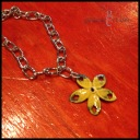 "BUTTERCUP - Wristlet with 1"" yellow enameled metal flower charm. Polished stainless steel link chain with lobster clasp. $15 as shown."