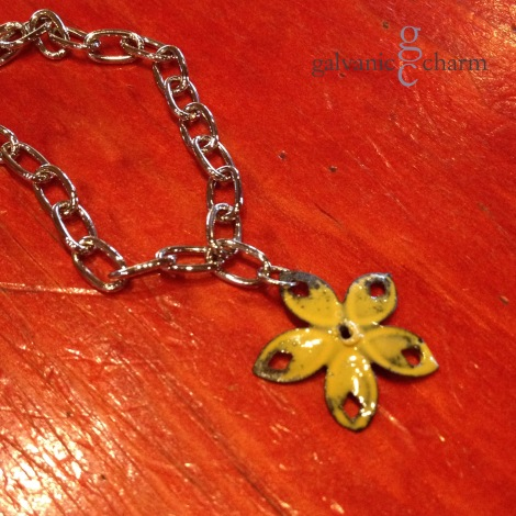 "BUTTERCUP - Wristlet with 1"" yellow enameled metal flower charm. Polished stainless steel link chain with lobster clasp. $15 as shown. Available directly or on Etsy."