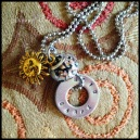 CARPE - Hand-stamped washer (carpe diem) in 1.5mm uppercase block font, yellow brass sun charm, and copper and gold flecked glass large hole bead. Silver-plated narrow ball chain. $25 as shown.