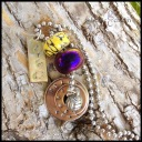 """DREW - Personalized necklace, hand-stamped with 2 washers, a 1"""" stainless steel tag, pewter volleyball charm, and yellow and purple beads. Stainless steel ball chain. $35 as shown."""