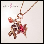 """EMERGE - Delicate stainless steel loops with rose pearl and pink Swarovski crystal droplets and dangling pewter folded ribbon, tiny cross, and butterfly charms. 18"""" rhodium plated fine ball chain with lobster clasp. $40 as shown."""