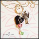 """FAIRYTAIL - Charm necklace with a pewter girl fairy charm, accented with black lacquer heart, rose glass bead, and wire wrapped sage Swarovski crystal drop dangling from a 3/4"""" silver plated textured circle. 18"""" rhodium plated tiny ball chain with lobster clasp. $25 as shown."""