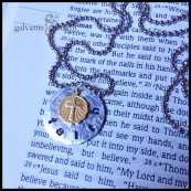 "FAITH - A beautiful way to express devotion, this necklace has a 3/4"" distressed soft strike aluminum circle, hand-stamped with ""faith,"" and features a circular 1/4"" brass cross charm . 3mm lowercase Gothic font. Stainless steel ball chain. $25 as shown."