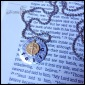 """FAITH - A beautiful way to express devotion, this necklace has a 3/4"""" distressed soft strike aluminum circle, hand-stamped with """"faith,"""" and features a circular 1/4"""" brass cross charm . 3mm lowercase Gothic font. Stainless steel ball chain. $25 as shown."""