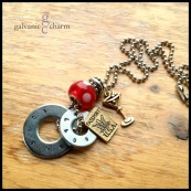 """FUNSTER - Two hand-stamped washers (funster, laugh). Brass martini and passport charms, red polka dot glass and stainless steel beads. 24"""" stainless steel ball chain. $45 as shown."""