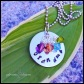 "GRANDCRYSTALS - Hand-stamped (grandma) 1"" silver plated solid circle with up to four wire wrapped Swarovski crystal birthstone drops ($5 per each additional drop). 18"" stainless steel ball chain. $40 as shown."