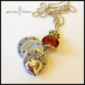 """HEARTBEAT - Mother's necklace with 4 hand-stamped washers. Stainless steel heart charm, amber-colored glass and peridot Swarovski crystal beads. 24"""" stainless steel ball chain. $45 as shown."""
