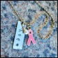 """HOPE - Breast cancer awareness wristlet, hand-stamped with 1"""" stainless steel tag (hope), wire wrapped pearl, and pewter and pink enamel folded ribbon charm. 7"""" silver plated ball chain (adjustable). $15 as shown."""