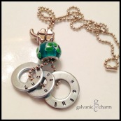 "IRISH - Three hand-stamped washers (luck o the irish). Stainless steel shamrock charm, emerald-colored clover design glass bead. 22"" stainless steel ball chain. $25 as shown."
