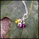 """JOINED - 3 wire wrapped Swarovski crystal birthstone and sterling silver initial drops. Shown with citrine (November) and amethyst (February). 18"""" extra-fine silver-plated cable chain. $30 as shown."""