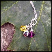 "JOINED - 3 wire wrapped Swarovski crystal birthstone and sterling silver initial drops. Shown with citrine (November) and amethyst (February). 18"" extra-fine silver-plated cable chain. $30 as shown."