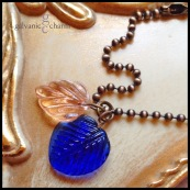 LEAFLET - Wristlet with royal blue and peach resin leaf charms. Antique brass ball chain. $15 as shown.