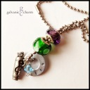 """MARILYN - Grandma's necklace with single hand-stamped washer. Pewter golf bag charm, aquamarine Swarovski crystal birthstone, green and amethyst-colored glass beads. 24"""" stainless steel ball chain. $45 as shown."""