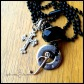 """OBSIDIAN - Mother's necklace with single hand-stamped washer. Stainless steel ornate cross and initial charm. Onyx-colored glass and pewter beads. 24"""" black coated ball chain. $48 as shown."""