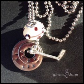"""PUCK - Booster necklace with 2 hand-stamped washers (puck is life), pewter hockey stick charm, and white lampwork bead with taupe accents. 18"""" stainless steel ball chain. $30 as shown."""