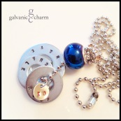 """ROCK CHALK - Booster necklace with 3 hand-stamped washers (rock chalk jayhawk) in 1.5mm uppercase block font, and thin silver plated disc (KU). Blue brushed steel and beryl rhinestone beads. 24"""" stainless steel ball chain. $40 as shown."""