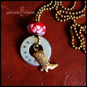 """SAM - Personalized hand-stamped washer in 1.5mm uppercase block font. Brass cowboy boot charm and red glass bead. 18"""" brass ball chain. $25 as shown."""