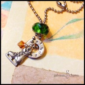 "SKATER - Personalized necklace with 1 hand-stamped washer in 3mm lowercase Bridgette font. Pewter ice skate charm, green glass bead, and wire wrapped Swarovski crystal birthstone drop. Pictured with topaz (November). 18"" stainless steel ball chain. $30 as shown."