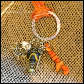 """SKULLOWEEN - Pewter skull and skeleton key charms with black and orange beading, hung on a silver-plated textured ring. 16"""" orange ribbon with silver lobster clasp. $25 as shown."""