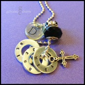 "TRIO - Mother's necklace with 3 hand-stamped washers in 1.5mm uppercase block font. Stainless steel small cross, clear acrylic initial disc, onyx-colored glass and rhinestone beads. 24"" stainless steel ball chain. $45 as shown."