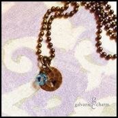 VINTAGE - Patterned antique brass circle with hand-stamped initial in 3mm lowercase Bridgette font. Shown with wire wrapped aquamarine (March) Swarovski crystal birthstone drop. $25 as shown.