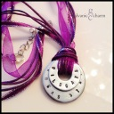 """WILDCATS - Booster necklace with 2 hand-stamped washer in 1.5mm uppercase block font with team name and mascot. 18"""" purple ribbon with stainless steel chain and clasp. $20 as shown."""
