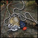 """WITCH - Hand-lacquered dictionary and pewter witch charms with wire wrapped tree-shaped black and orange beads. 18"""" stainless steel ball chain. $25 as shown."""