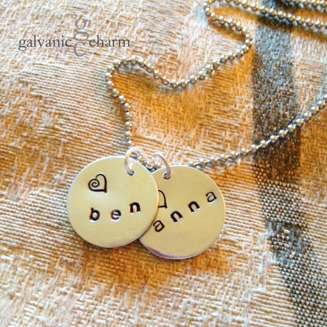 "BENANNA - Mother's necklace with two 1/2"" hand-stamped circles. 3mm lowercase Gothic font. Stainless steel ball chain. $25 as shown."