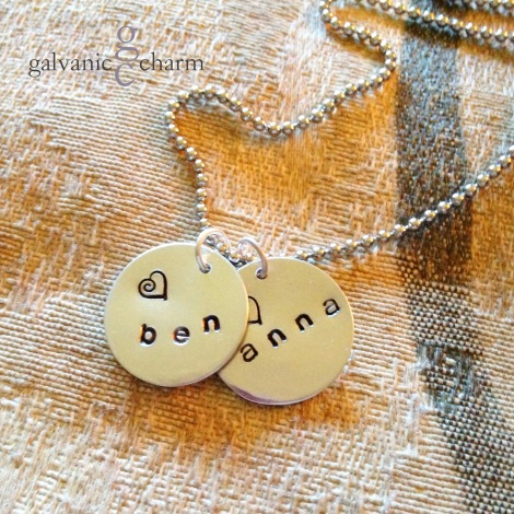 "BENANNA - Mother's necklace with two hand-stamped 1"" soft strike aluminum circles. 3mm lowercase Gothic font. Stainless steel ball chain. $25 as shown. Available directly or on Etsy."
