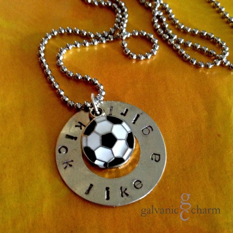 "KICK - Perfect for any girl (or team of girls) to show her soccer superstarness, this 1 3/8"" nickel silver washer, is hand-stamped with ""kick like a girl,"" and features an enameled soccer ball charm. 3mm lowercase Gothic font. Stainless steel ball chain. $20 as shown. Bulk discount available for orders of 10 or more."