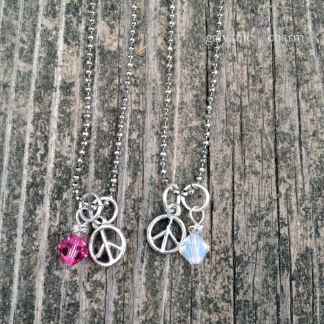 "PEACE GIRL - Birthstone necklace with pewter peace sign and wire wrapped Swarovski crystal droplet. 14"" rhodium plated fine ball chain with lobster clasp. $20 as shown."