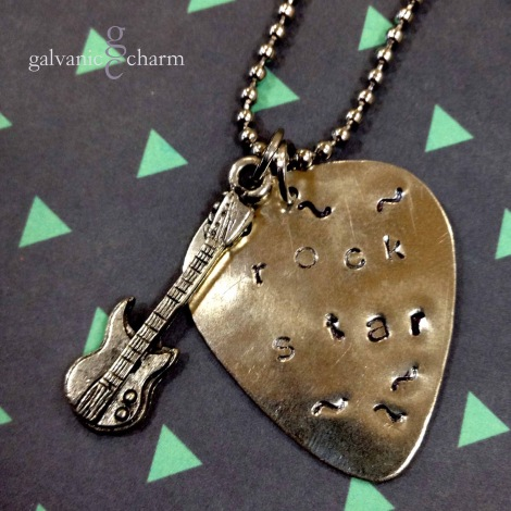 "ROCK STAR - Have a favorite musician? Here's a necklace with a nickel silver guitar pick, hand-stamped ""rock star,"" with a pewter guitar charm. Stainless steel ball chain. $20 as shown."