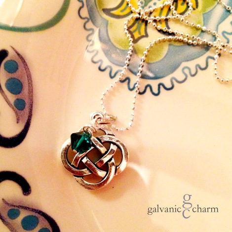 """CELTIC - Birthstone necklace with pewter Celtic knot charm and wire wrapped Swarovski crystal drop, pictured with emerald (May). 18"""" silver filled light cable chain with circle clasp. $20 as shown. Available directly or on Etsy."""