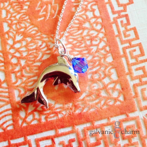 "DOLPHIN - Birthstone necklace with pewter dolphin charm and wire wrapped Swarovski crystal drop, pictured with sapphire (September). 18"" silver filled light cable chain with circle clasp. $20 as shown. Available directly or on Etsy."