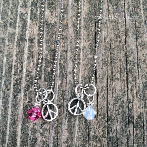 PEACE GIRL - Birthstone necklace with pewter peace sign and wire wrapped Swarovski crystal droplet, pictured in pink tourmaline and opal (October). Rhodium plated fine ball chain with lobster clasp. $20 each as shown. Available directly or on Etsy.