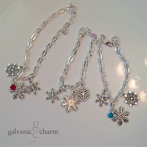 """SNOWFLAKES BRACELET - Charm bracelet with three 2cm pewter snowflakes, 7.5"""" (adjustable) silver plated cable chain with lobster clasp, and optional wire wrapped Swarovski crystal drop. If ordering with a birthstone or crystal, please specify month or color. $15 apiece as shown (without crystal) or $20 apiece (with crystal). Available directly or on Etsy."""