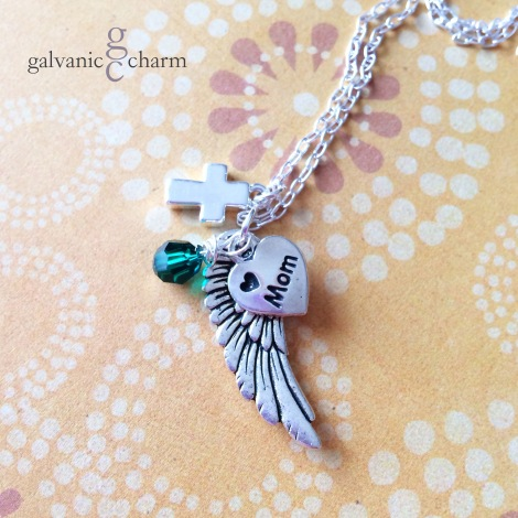 "ANGEL MOM - Memorial necklace with pewter wing, small cross, and engraved ""mom"" heart charms, and wire wrapped Swarovski round crystal birthstone drop, pictured in emerald (May). 18"" fine silver plated cable chain. $30 as shown."