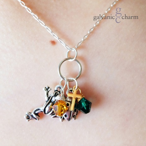 """PATTY KATE - Memorial necklace with dangled pewter frog and ladybug charms, tiny 14k gold cross, and wire wrapped Swarovski crystal birthstone drops, pictured in topaz (November) and emerald (May). 18"""" silver plated light cable chain. $35 as shown."""