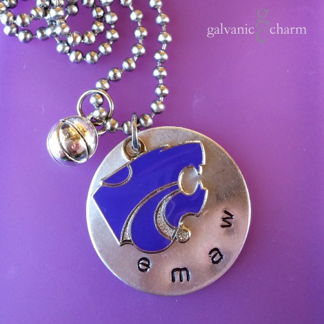 "EMAW - Team necklace with 1"" nickel silver disc, hand-stamped with ""emaw"" in 3mm lowercase Gothic font. Pewter basketball charm, and purple enamel Power Cat. 18"" stainless steel ball chain. $30 as shown. Available directly or on Etsy."
